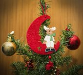reindeer sitting on the moon on a christmas tree