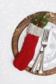 Christmas table setting with antique silverware