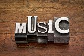 music word in mixed vintage metal type printing blocks over grunge wood