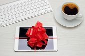 Tablet wrapped with large red bow