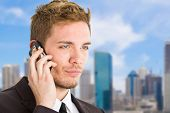 Portrait of an handsome businessman talking on the phone