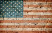 USA flag painted on brick wall