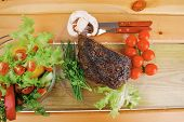 hot beef on transparent plate with salad bowl