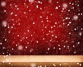 Christmas ackground with wooden table over bokeh
