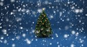 Realistic beautiful snow on a blue background with Christmas tree. Design elements for holiday cards
