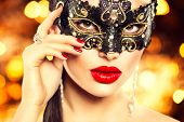 stock photo of christmas party  - Beauty model woman wearing venetian masquerade carnival mask at party - JPG