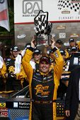 Elkhart Lake, WI - Jun 21, 2014:  Brendan Gaughan (62) holds off the rest of the field to win the Gardner Denver 200 Fired Up by Johnsonville at Road America in Elkhart Lake, WI.