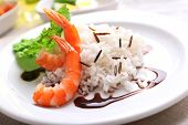 Boiled rice with shrimps served on table, close-up