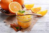 Delicious orange jam on table close-up
