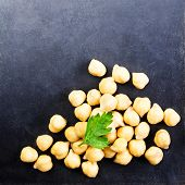 Golden  Chick-pea Cereal  Over Black  Chalk Board  Table Close Up.  Traditional Indian Food