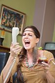 Woman Drinking And Singing At Phone