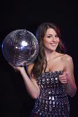 Woman with disco ball showing thumb up