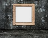 Blank Whiteboard With Wooden Frame On Dark Mottled Concrete Room