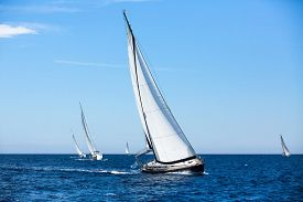 image of sailing vessels  - Group of sail yachts in regatta in open the Sea - JPG