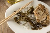 foto of glass noodles  - Glass noodles with laminaria and chiken with herbs horizontal selective focus - JPG