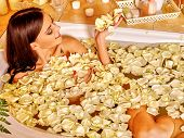 stock photo of black woman spa  - Woman relaxing at water spa - JPG