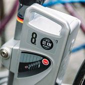 stock photo of clos  - Electric bicycle motor closeup detail in urban environment - JPG