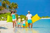 foto of children beach  - Happy beautiful family on a beach during summer vacation - JPG