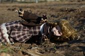 picture of forlorn  - Broken porcelain doll lying on the ground - JPG