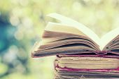 foto of law-books  - Close up on old book on colorful bokeh background  - JPG