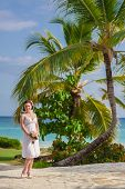 stock photo of married  - young loving couple on tropical sea background  - JPG