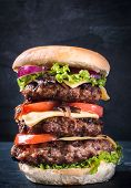 picture of beef-burger  - Triple beef burger with cheese and grilled onion on dark backgroundselective focus - JPG