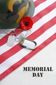 pic of memorial  - USA Memorial Day concept with dog tags and red remembrance poppy on American stars and stripes flag on white vintage wood table with title text - JPG