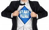 pic of start over  - businessman showing Start here words underneath his shirt over white background - JPG