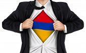 stock photo of armenia  - businessman showing Armenia flag underneath his shirt over white background - JPG