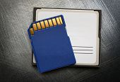picture of memory stick  - Blue compact memory card for camera on metal background - JPG