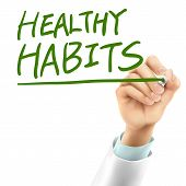 picture of  habits  - doctor writing healthy habits words in the air - JPG