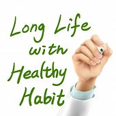 stock photo of  habits  - doctor writing long life with healthy habit words in the air - JPG