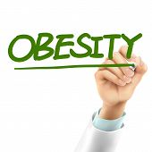 stock photo of obesity  - doctor writing obesity word in the air - JPG