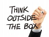 image of thinking outside box  - think outside the box words written by hand on a transparent board - JPG