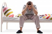 foto of insane  - Young man suffering from insomnia isolated against white background - JPG