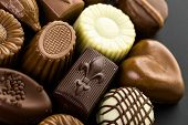 picture of truffle  - Delicious chocolate truffles and candy on a dark background - JPG