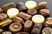 foto of truffle  - Delicious chocolate truffles and candy on a dark background - JPG