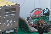 image of generator  - Yellow gasoline generator is power for old and rust car - JPG