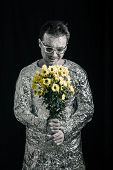 pic of spaceman  - Portrait of satisfied spaceman holding flowers - JPG