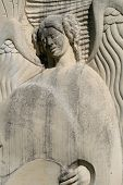 picture of funeral home  - beautiful carved angel in stone - JPG