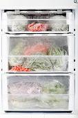 picture of frozen food  - Freezer with open door and frozen food inside - JPG