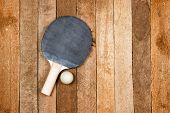 picture of ping pong  - Vintage ping pong paddle on wooden background - JPG