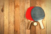 picture of ping pong  - Ping pong paddles and ball on wooden texture with copyspace - JPG