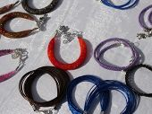 pic of flea  - colorful bracelets and other craft items of jewelry for sale at flea market - JPG