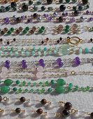 picture of flea  - many valuable necklaces in gold and gemstones for sale at flea market - JPG