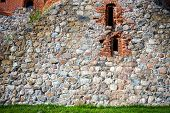 pic of yellow castle  - Old stone castle wall with some windows - JPG