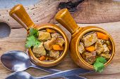 stock photo of stew  - Portion of traditional beef stew with carrots - JPG