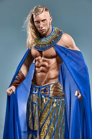 stock photo of pharaohs  - The man in the image of the ancient Egyptian Pharaoh  on blue background - JPG
