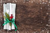 Christmas table place setting with christmas pine branches,ribbon and bow. Christmas holidays backgr poster