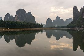 stock photo of early 20s  - the famous 20 yuan banknote scenery taken early in the morning when the li river is calm - JPG